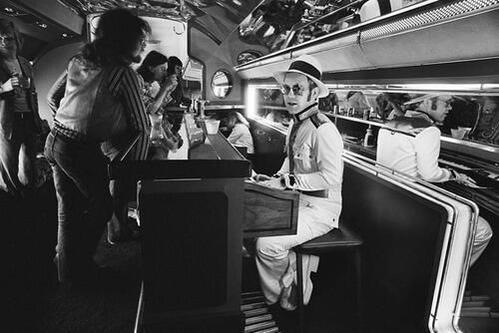 Elton John on board his private plane, 1974 (By Terry O'Neill)